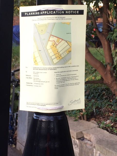 Planning application notice on a lamp post